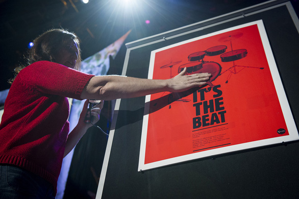 Kate Stone plays a drum kit ... that's printed on poster. Photo: James Duncan Davidson