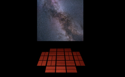 Mock-up of a proposed installation in which live chanting triggers the sounds of the stars. The orange squares are meditation cushions arranged in the shape of the Kepler telescope's detectors, and the projection is of the star field from which the data originate – near the constellations of Cygnus (the swan) and Lyra (the harp). Image: Lucianne Walkowicz