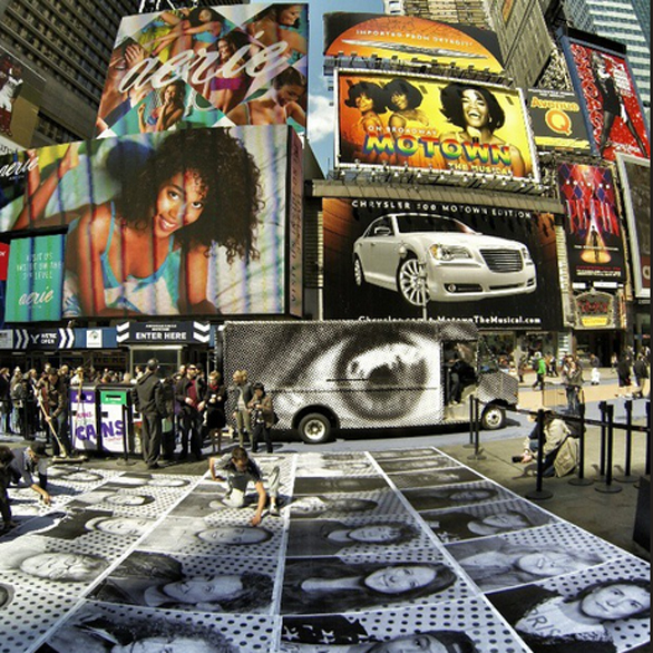 """Artist JR's phototruck is parked in Times Square, New York City, through May 10 for a project he calls """"Art vs. Advertising."""" Photo: http://instagram.com/newyorkermag"""