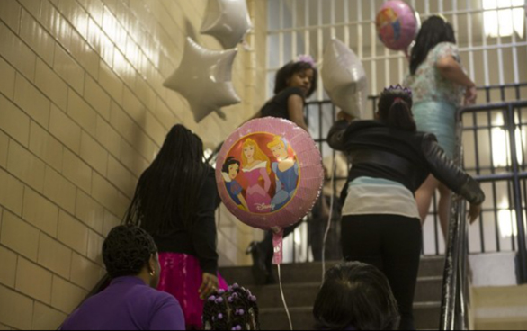 Twelve girls enter the Richmond City Jail for a father-daughter dance. Photo: Marvin Joseph/The Washington Post
