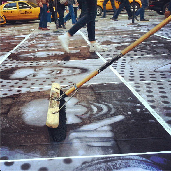 Pasting in action. Photo: Instagram/JR