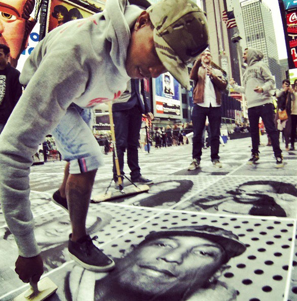 Pharrell Williams takes a moment to add his image to the mosaic. Photo: Instagram/JR