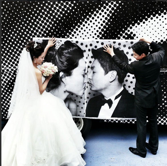 A bride and groom make their portraits kiss at the INSIDE OUT photo truck. Image: Instagram/JR