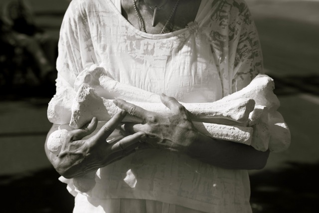 Participant carrying bones for a bone laying installation. Photo: Joanne Teasdale