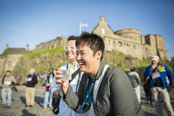 TEDx organizers crack up outside Edinburgh Castle at TEDGlobal 2013. Photo: Ryan Lash