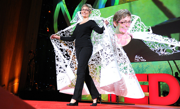 Beatrice Coron shows off an incredible cape, made out of cut paper, at TED2011. Photo: James Duncan Davidson