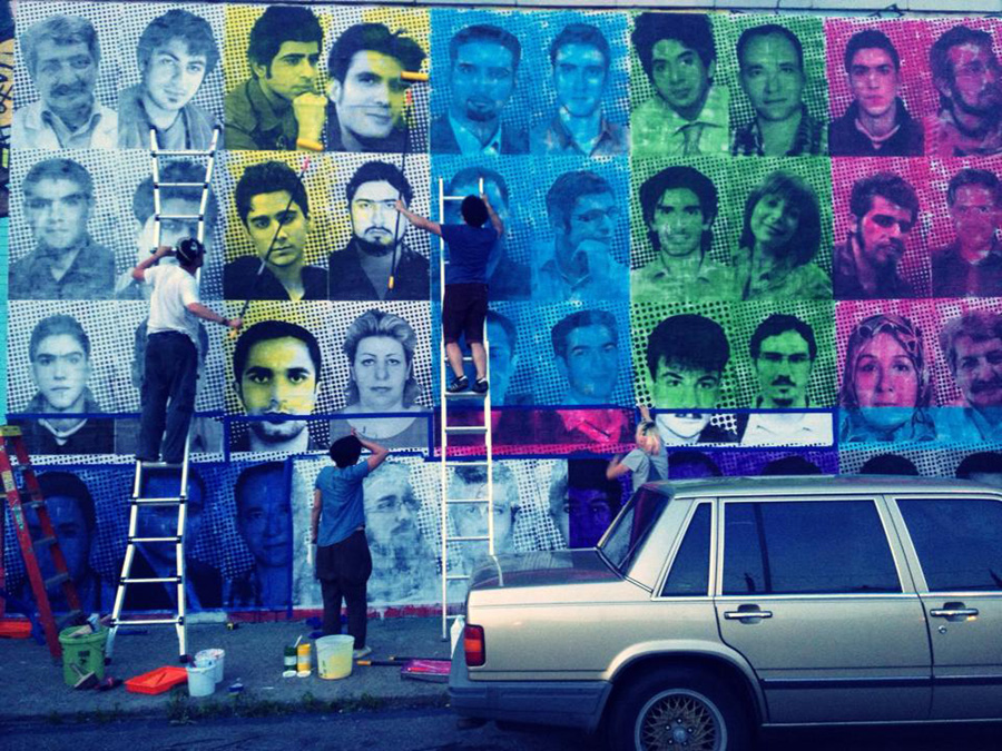 Brooklyn, NY/Iran: After learning that only person from Iran had participated in the world's largest participatory art project, Saman Arbabi pasted the faces of 40 people who were killed in the aftermath of the 2009 Iranian presidential elections.