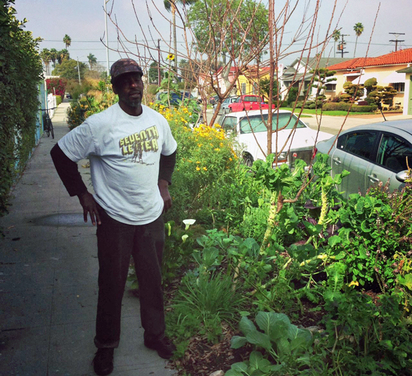Ron Finley proudly stands beside his curbside vegetable forest during a gardening party the week after TED2013. Photo: Nick Weinberg