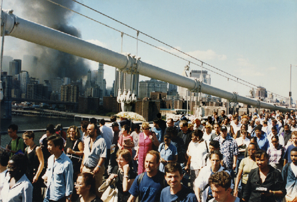 Thousands flooded the Brooklyn Bridge to head home. Most people were unharmed, but sometimes you would see someone covered in soot from head to toe. Those people always had blank expressions and seemed very tired. Submitted by Adam Bezer.
