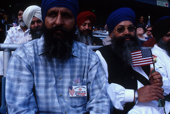 """""""A Prayer for America"""" at Yankee Stadium. A group of Sikhs show their patriotism. After September 11, there were several incidents of Sikhs being beaten - having been mistaken for Muslims - across the US. Submitted by Harry Zernike."""