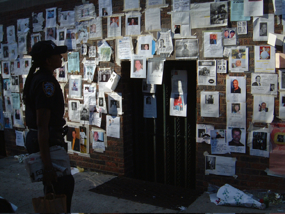 Near the Armory on Lexington Avenue, a policewoman scans the missing person flyers. Submitted by Paul McGeiver.