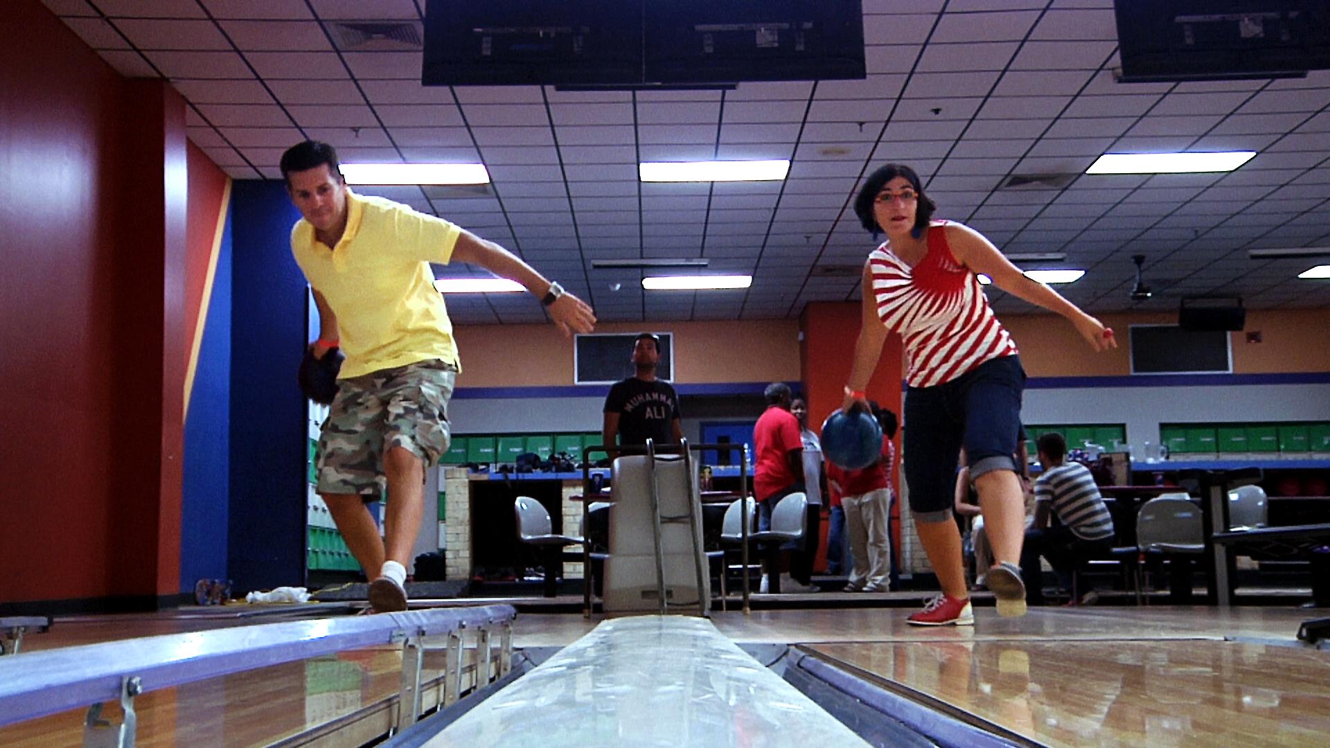 The Muslims Are Coming!: Dean Obeidalla and Negin Farsad bowl down the alley.