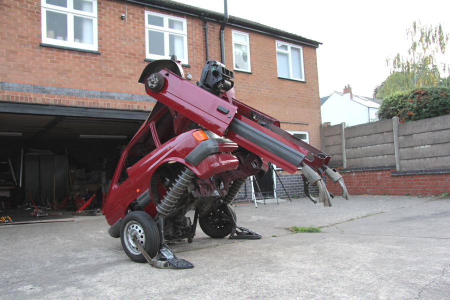 A Ford Fiesta becomes a squatting Transformer in this new sculpture by Hetain Patel. Photo: Hetain Patel