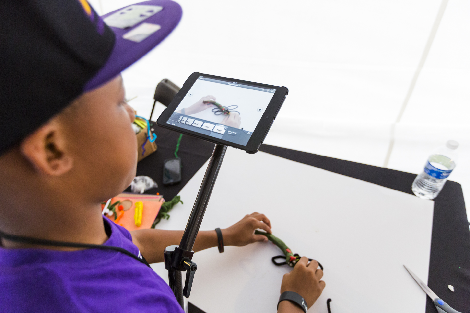 An attendee tries his hand at stop-motion, at TED-Ed's Animation Station. Photo: Ryan Lash