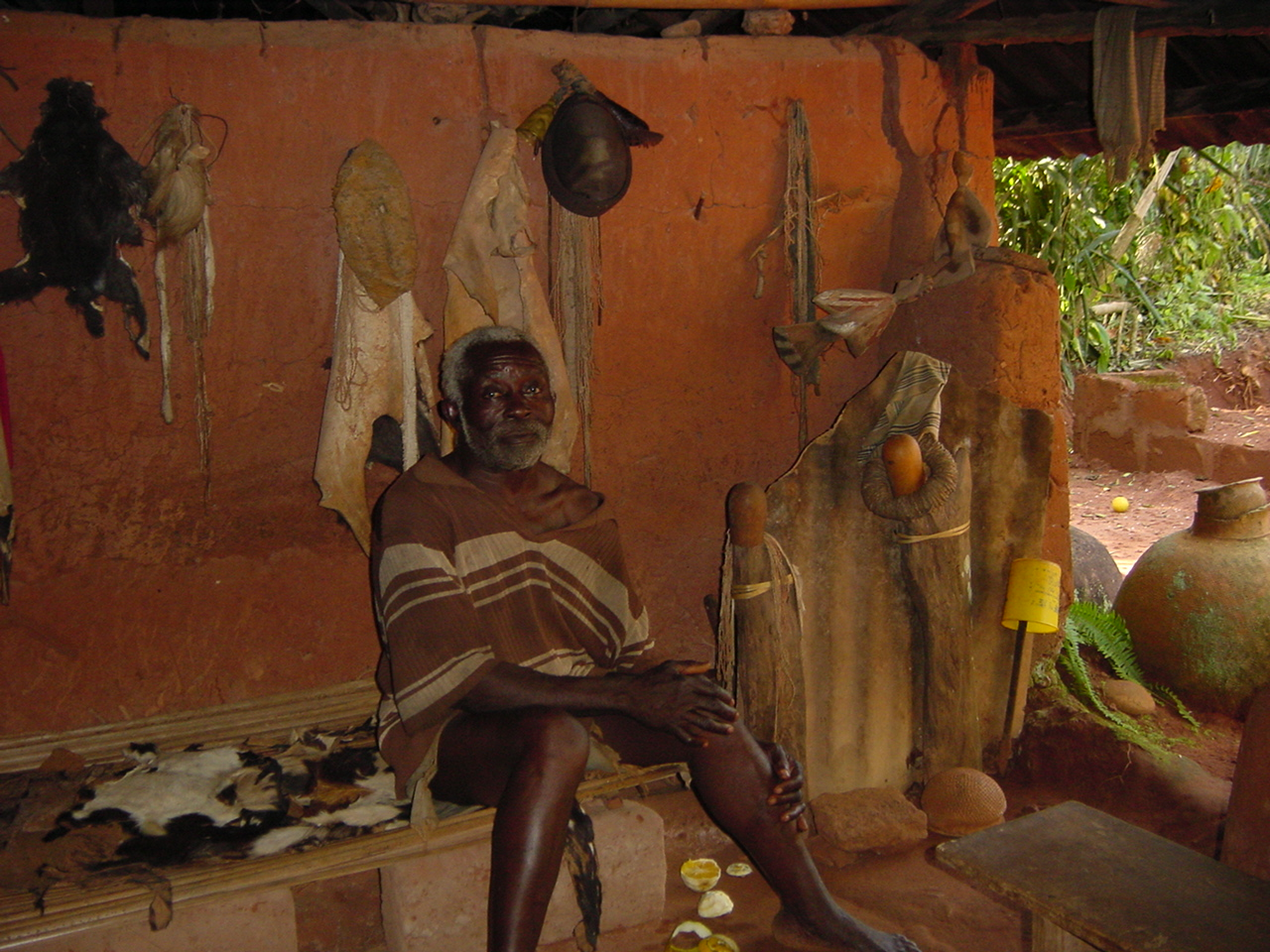 Mr. Ezeja Atama: the atama (chief priest) Ugwuojome of Nsukka sitting inside his shrine. Such priests examine the motions of heavenly bodies to come up with the calendar of her people. Photo: Johnson Urama