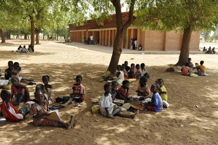 A group of children takes a break under a mango tree outside the Gando school extension. Photo: Erik-Jan Ouwerkerk