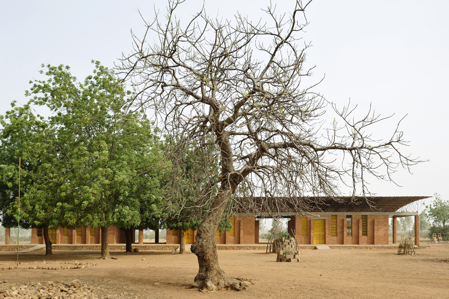 Kéré designed a primary school for Gando in 1999 and, with the help of residents of the village, construction was completed in 2001. The school's walls are made from compressed clay, and the ceiling is made of corrugated metal on a steel truss to let air flow in freely. It has three classrooms, separated by shaded outdoor spaces. Photo: Erik-Jan Ouwerkerk