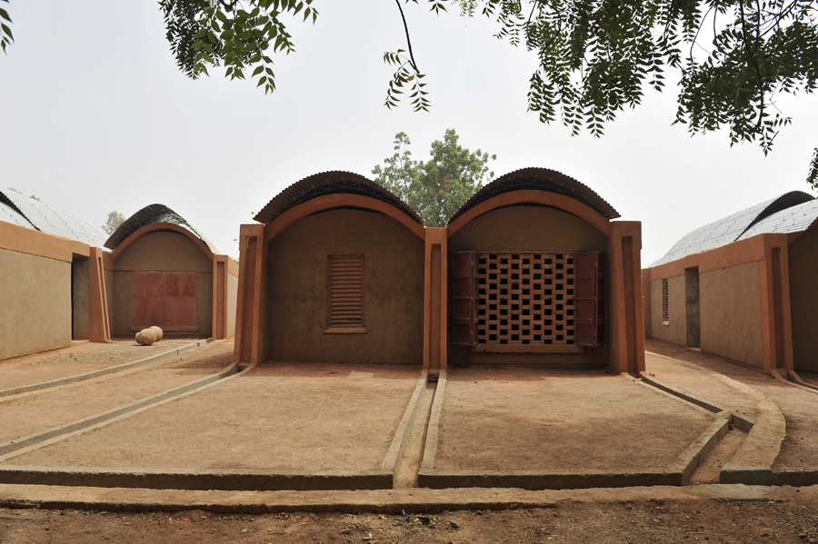 One of the challenges of Gando's schools: attracting talented teachers to the rural location. And so, the village built six homes for teachers and their families, which are arranged in an arc to the south of the school. Construction was completed in 2004. Photo: Erik-Jan Ouwerkerk
