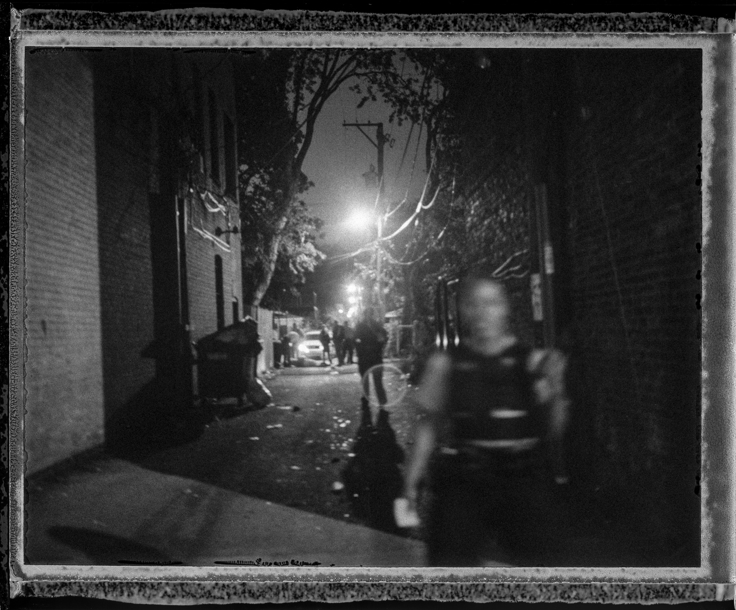 """Just minutes after a double shooting a man lies in an alley near the 7100 S. Rhodes block in the Grand Crossing neighborhood on Chicago's South Side. The shooting was in apparent retaliation to a shooting that had happened the previous day. In """"Chi-Raq,"""" more young people have died in the past five years than in Afghanistan and Iraq combined. There still is not one trauma unit anywhere on the South Side, despite the fact that the city leads the country in the number of homicides, with the majority occurring south of the Loop. But to understand what's at stake, we must look far deeper than the latest crime scene to see the immense waste of human potential that's being lost with each violent act. The media's never-ending focus on the violence obscures a larger and far more significant truth: that the wholesale neglect has led to the practical destruction of these communities."""