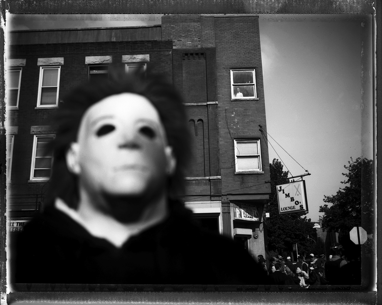 A man poses wearing his mask from the Friday the 13th movies. He stand in front of Jimbo's Bar, which was a local legendary establishment in the Bridgeport neighborhood. Bridgeport, home to Mayor Richard J. Daley, was known as one of the most brutally racist neighborhoods in the city and to this day has resisted integration by African-Americans, although many Asians and Latinos have moved into the neighborhood in the past few years.