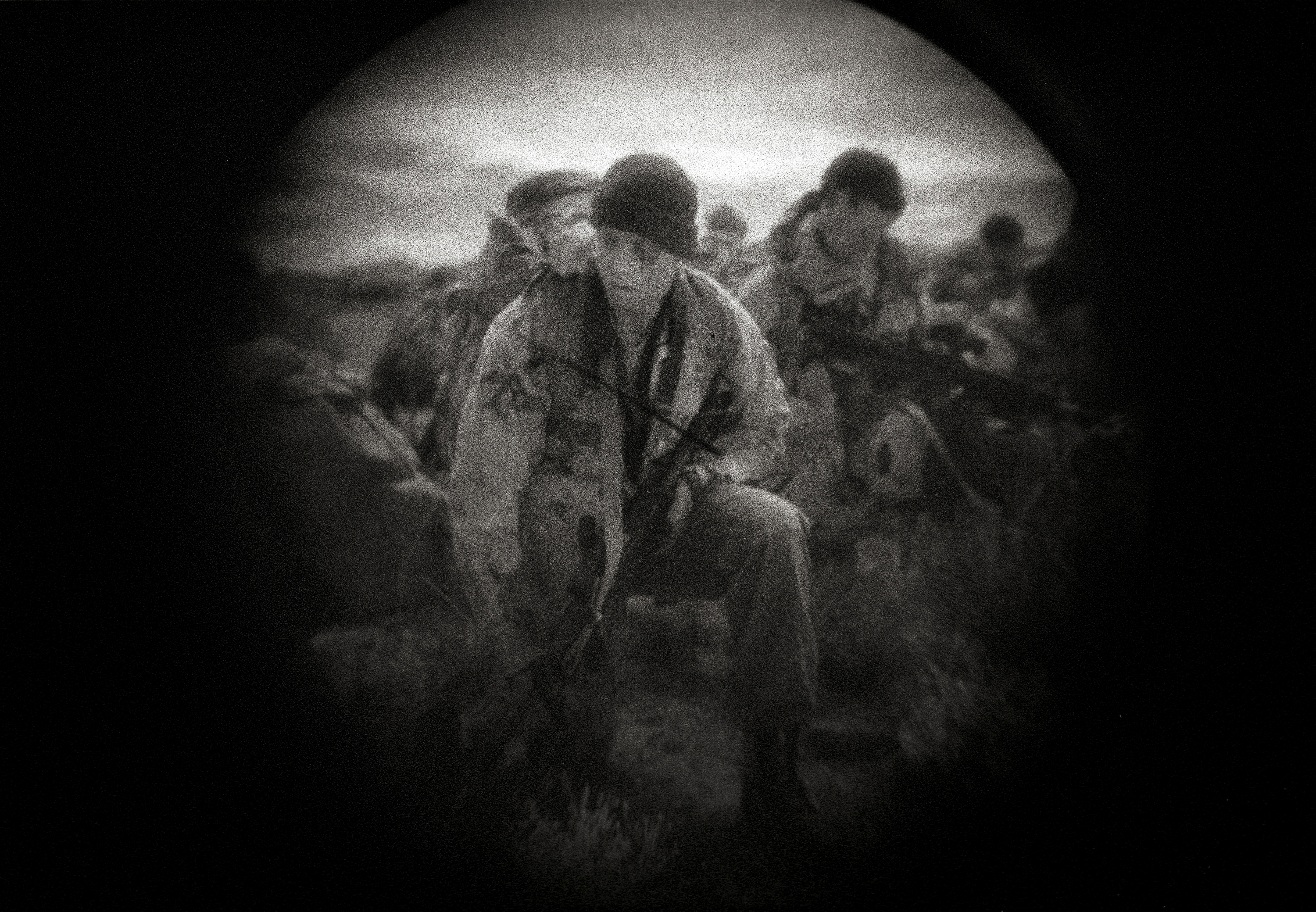 A night training operation by the United States Border Patrol Special Response Team Training in New Mexico. The photograph was made through night vision glasses.