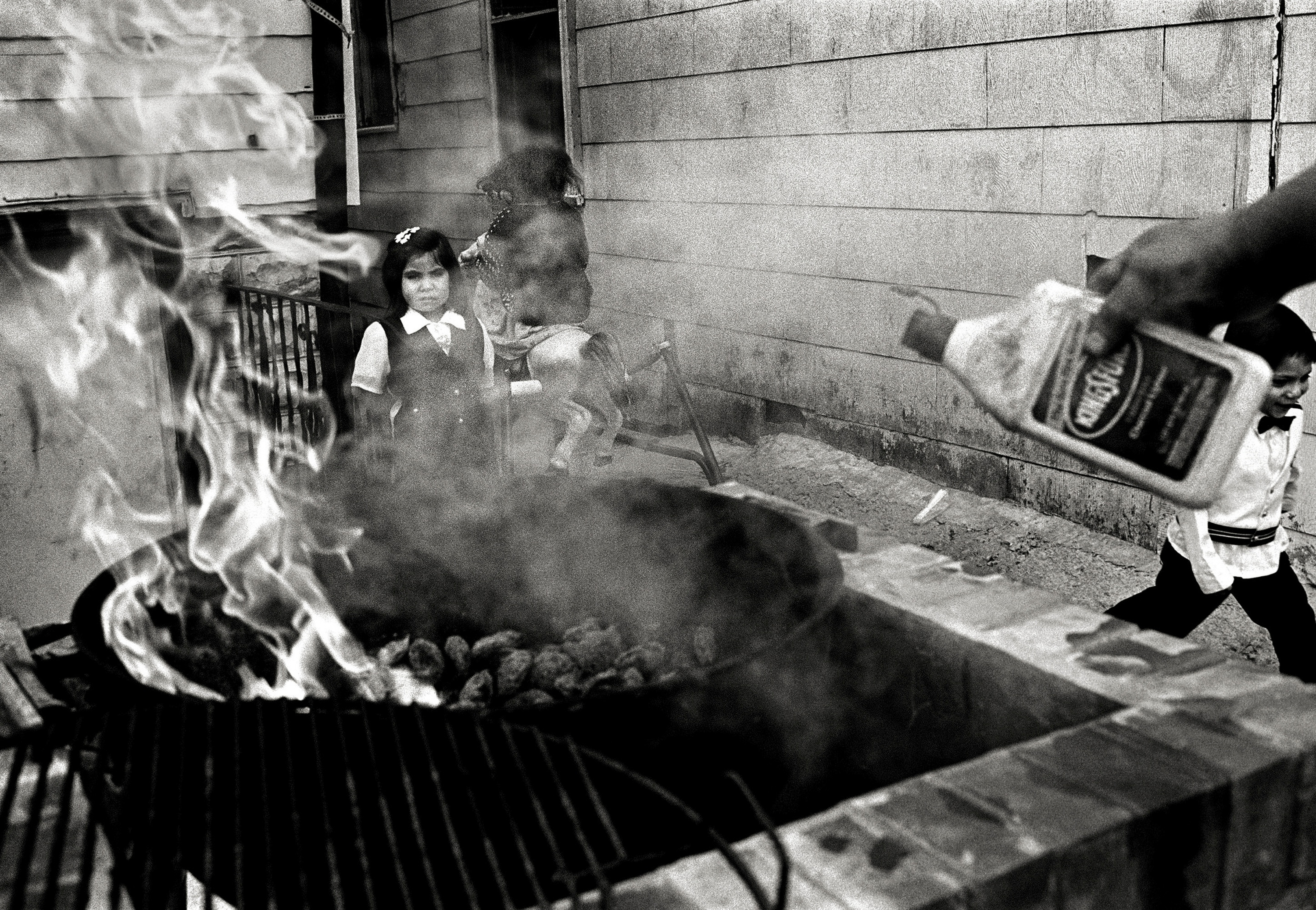 At the inauguration of the first Back of the Yards Worker Center, 4314 S. Hermitage Ave., the Latino Union of Chicago held a barbecue that cousins Rosa and Ruben Solis enjoyed.  The Solis family lives in the front of the house, while the worker center is located at the back.  The center was founded by the Latino Union to offer day laborers an alternative to the many temporary employment agencies that dot the city and offer their employees minimum wage and no benefits.  The worker center has since closed, but the Latino Union still advocates for Latino immigrants on Chicago's South Side.