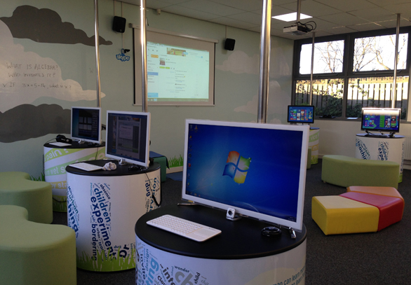 The learning lab has both computer stations and an area for group discussion.
