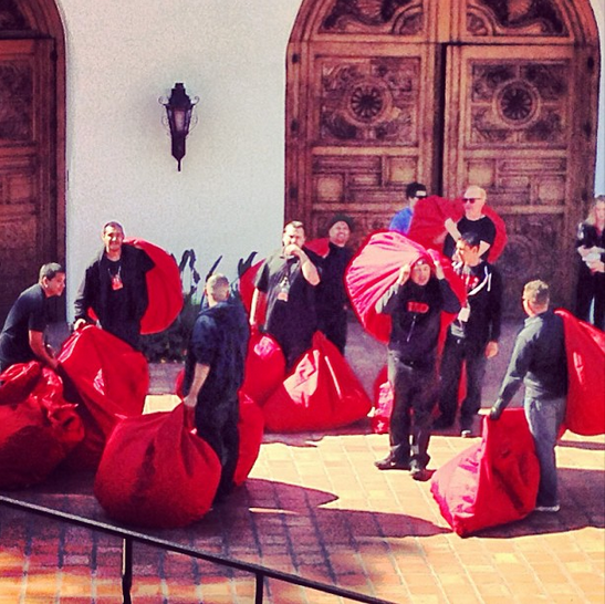 Red beanbags have always been a signature at TEDActive. Here, the crew loads up the theater before attendees arrive.