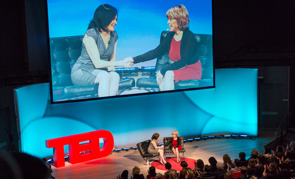 Sheryl Sandberg shakes hands with Pat Mitchell, who urged her to talk about women and leadership at TEDWomen in 2010. The talk became her book, Lean In. Photo: Kristoffer Heacox