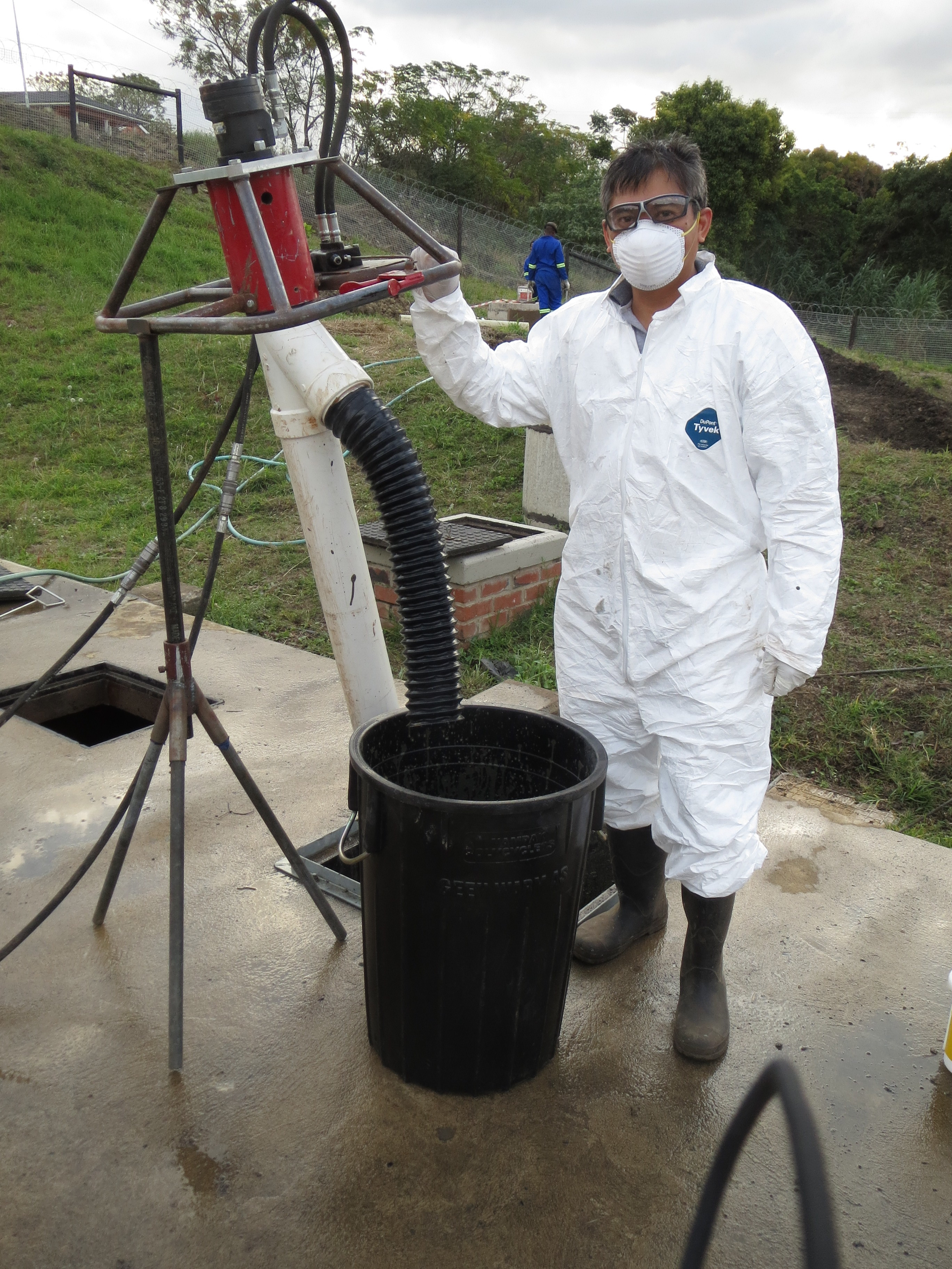 """With """"The Excrevator"""", the modified power auger designed at North Carolina State University, for emptying pit latrines.  The auger was being tested in Durban, South Africa. Photo: Bjorn Pietruschka"""