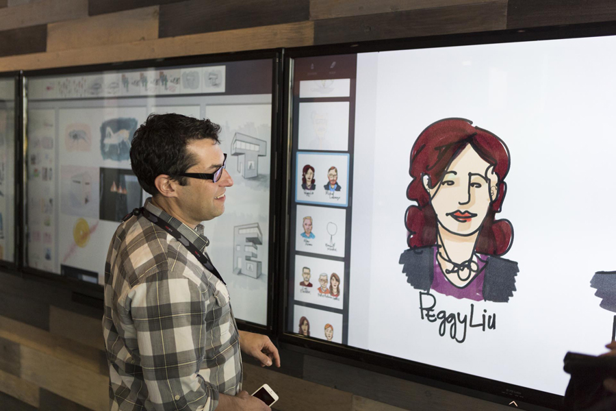 In the Adobe Drawing Lab, a speaker looks at a rendering of speaker Peggy Liu. Photo: Bret Hartman