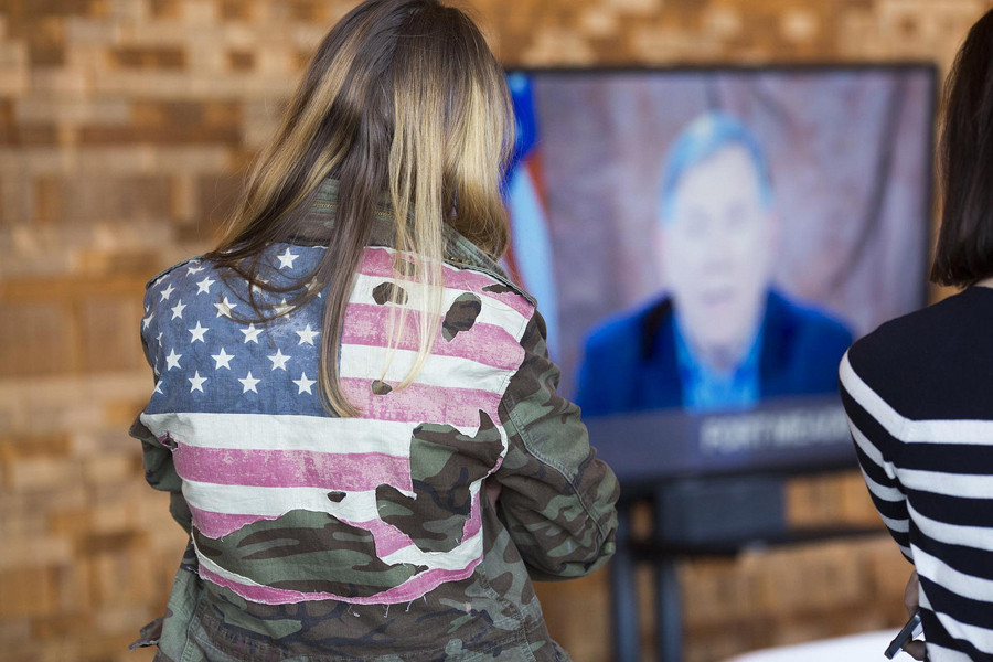 An attendee watches a Q&A with NSA deputy director Richard Ledgett. Photo: Ryan Lash