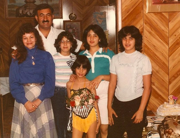 "Maysoon with her family in 1984. She says, ""Gotta love the feathers and paneling and my sister's upside-down-glasses."""