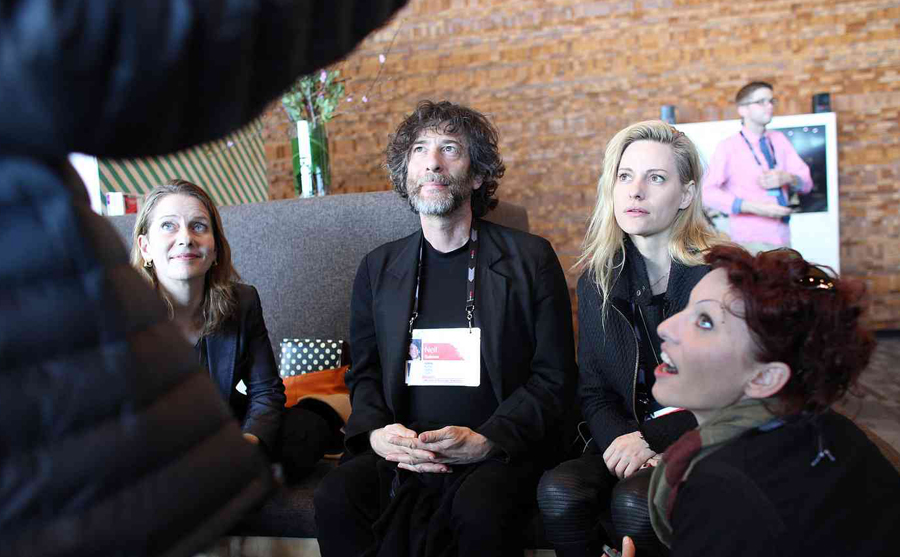 By daylight, Neil Gaiman is captivated by someone else's story at TED2014. Photo: Ryan Lash