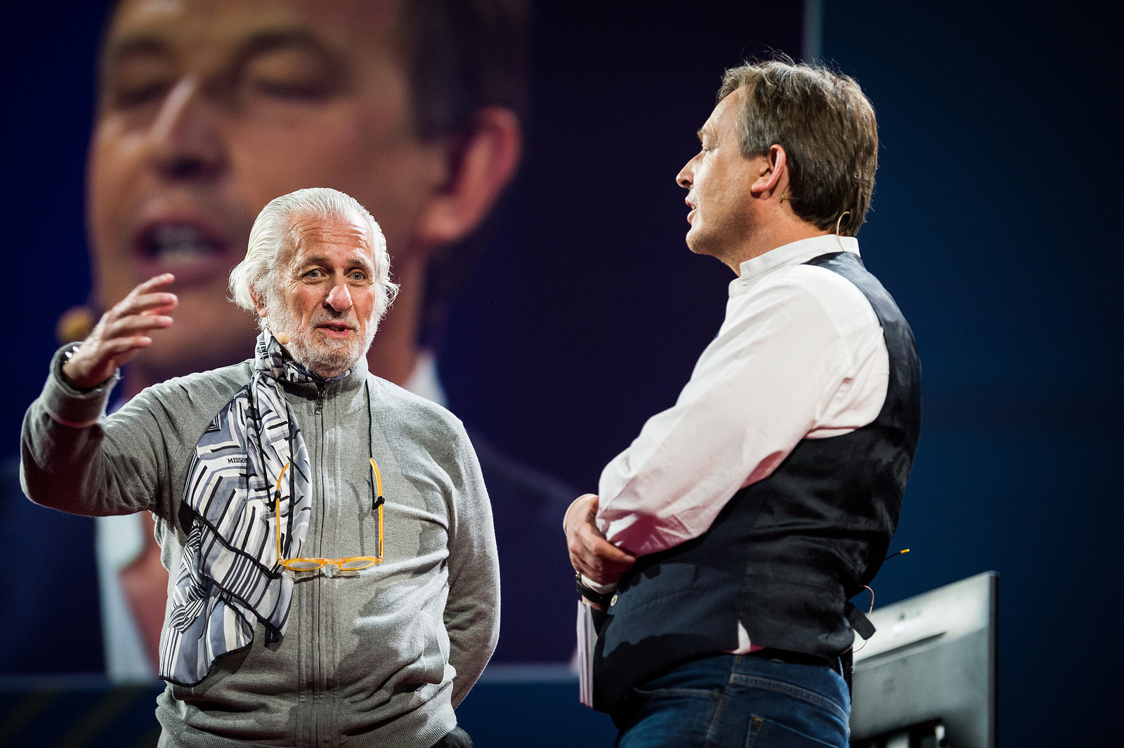 Chris Anderson presents a scarf to TED founder, Richard Saul Wurman. Photo: James Duncan Davidson