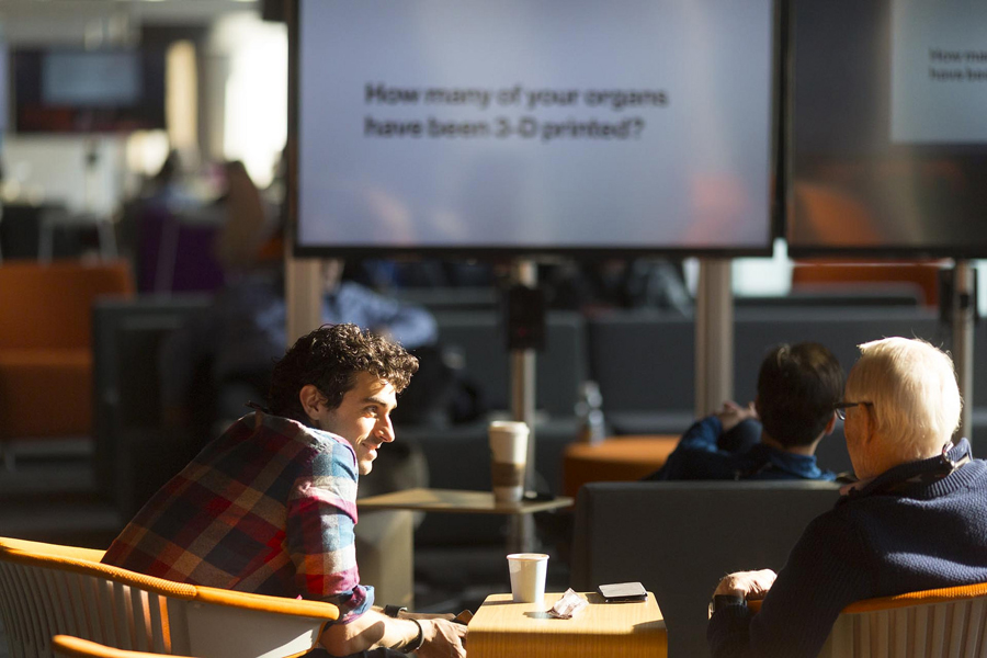 In bright and sunny simulcast lounges, attendees can chat while they watch.