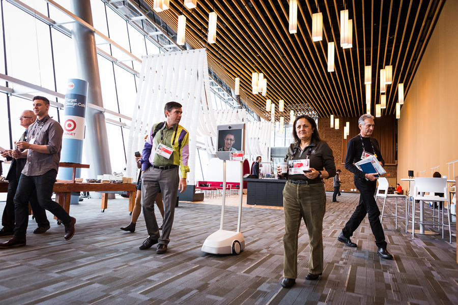 Edward Snowden walks, err rolls, around the convention center like any other attendee. Photo: Bret Hartman
