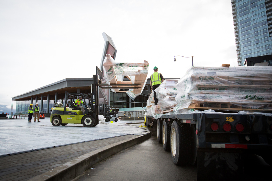 Trucks are unloaded outside the Convention Centre. Photo: Ryan Lash