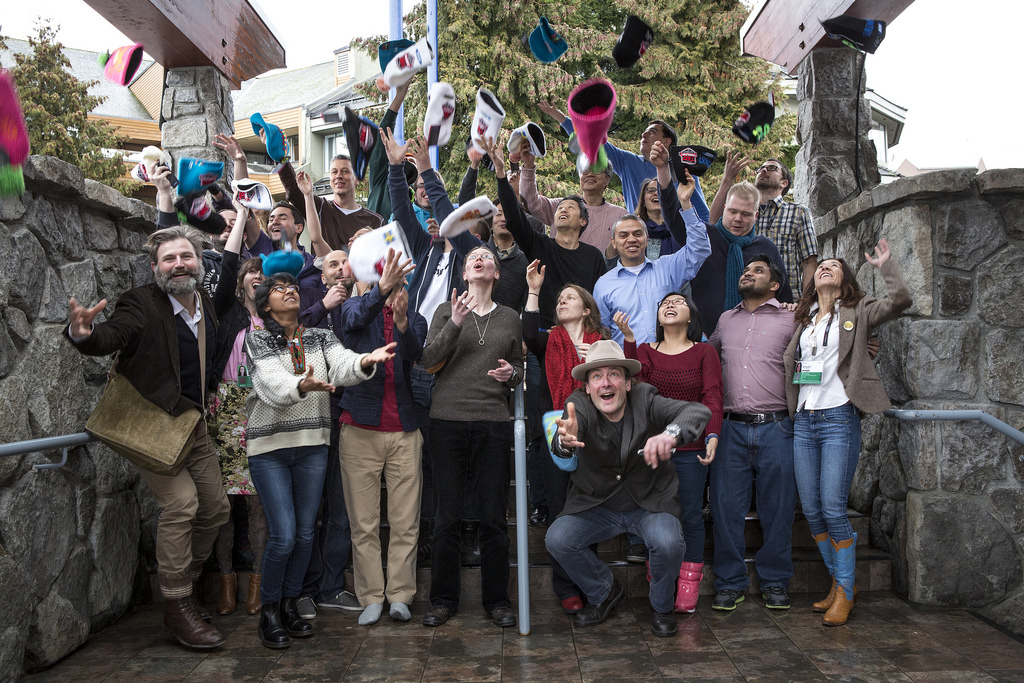 Translators from TED's Open Translation Project throw up their hats after a workshop at TEDActive 2014 in Whistler. Photo: Marla Aufmuth