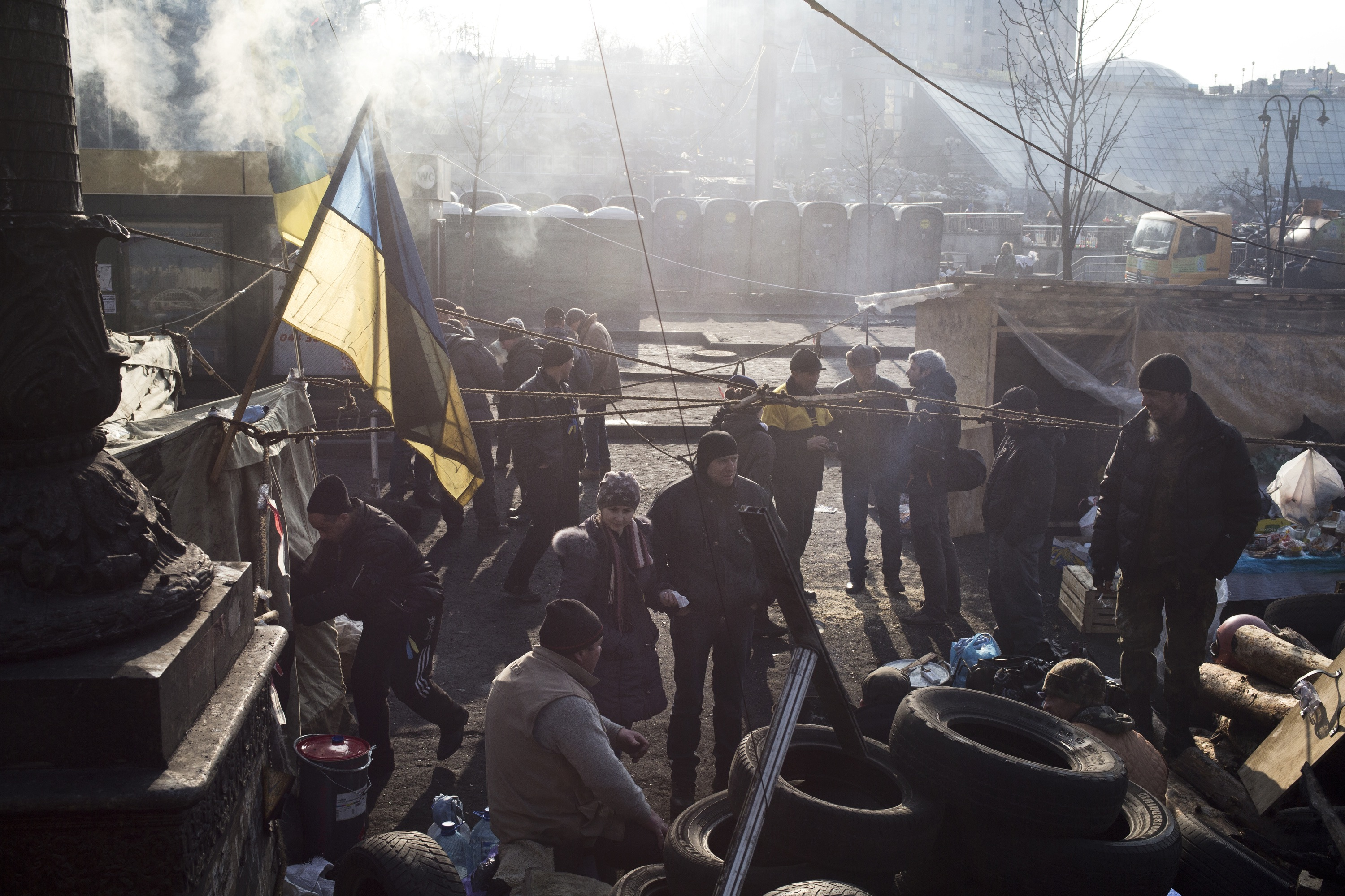 Anti-government protesters stand near barricades and tents during a sit-in of Independence Square in Kiev, Ukraine on Feb. 24, 2014. (Ed Ou/Reportage by Getty Images)