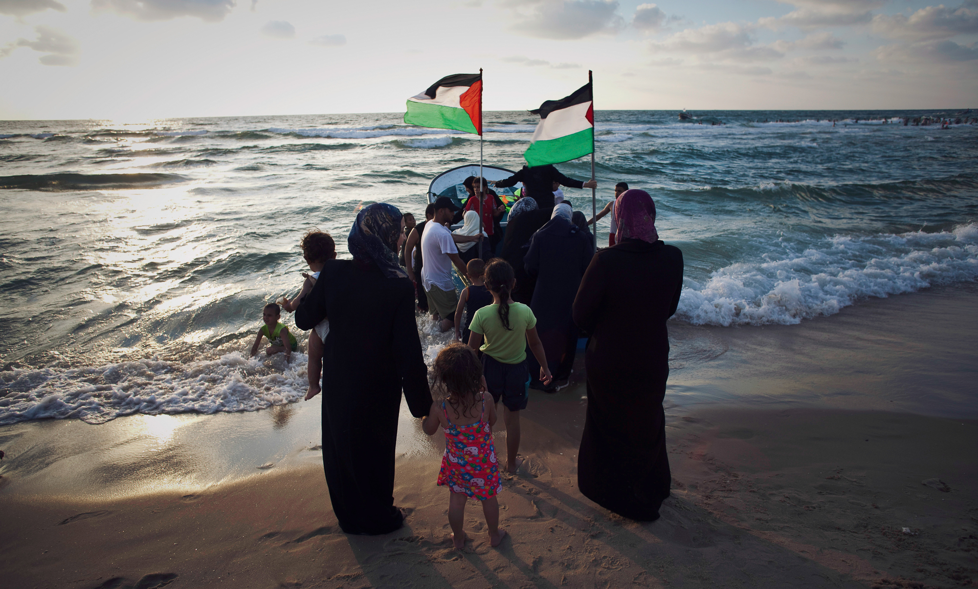 Palestinian women and children waiting for their turn for a boat ride in Gaza's sea. Photo by Eman Mohammed/Getty Images for WHAT'S NEXT