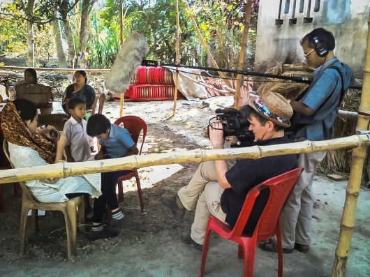 Filmmaker Jerry Rothwell films a family in Korakati, India. He is making a documentary that tells the story of the School in the Cloud. Photo: Courtesy of Jerry Rothwell