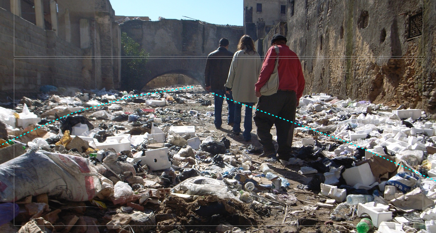 Before: A portion of the Fez river before uncovering, the concrete plaza being used as a dump. The blue marks indicate the locaation of the river. Image: Aziza Chaouni