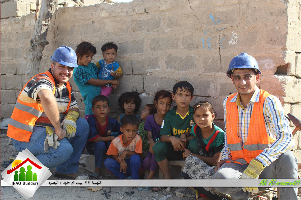 Elaf Mohammed (left) poses with the children whose home the team helped rebuild in Basrah. Photo: Courtesy of Iraq Builders