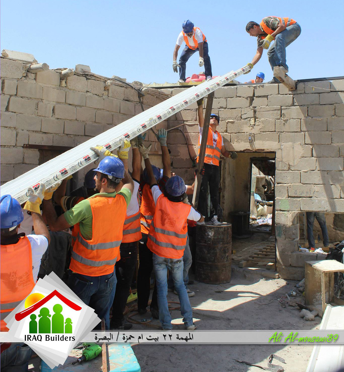 A team from Iraq Builders puts a new roof on a bombed-out home in Basrah, Iraq last August. Photo: Courtesy of Iraq Builders