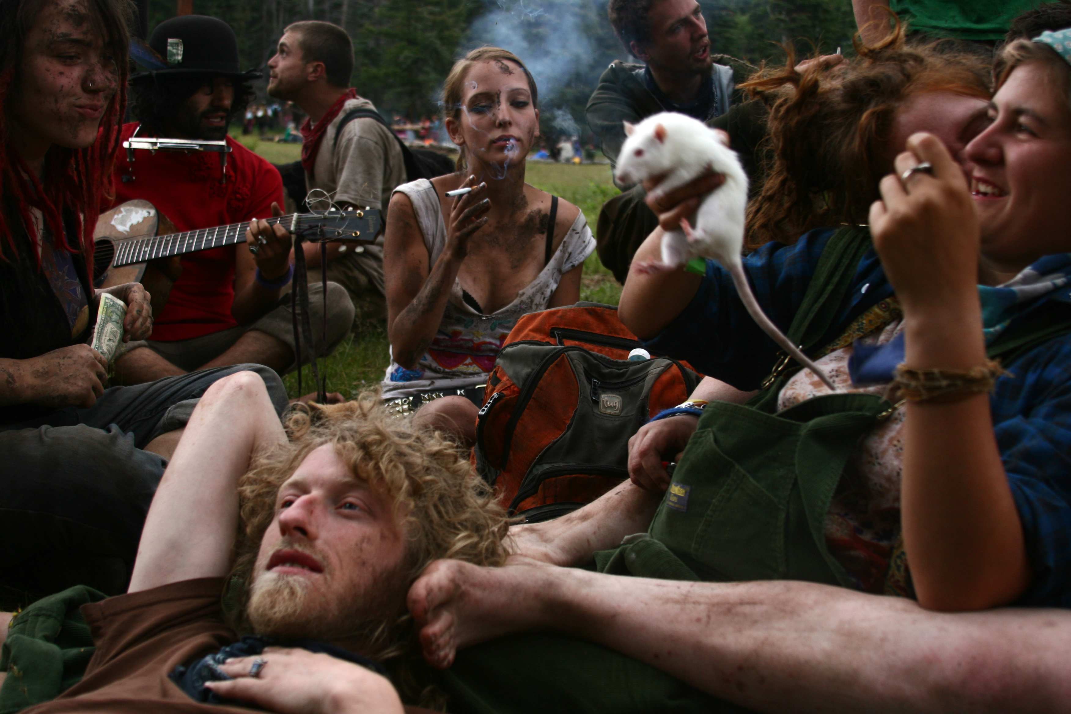 """Young nomads congregate at the """"Dirty Kids Corner"""" at the National Rainbow Gathering in the Santa Fe National Forest, New Mexico. July 2009. Photo: Kitra Cahana"""