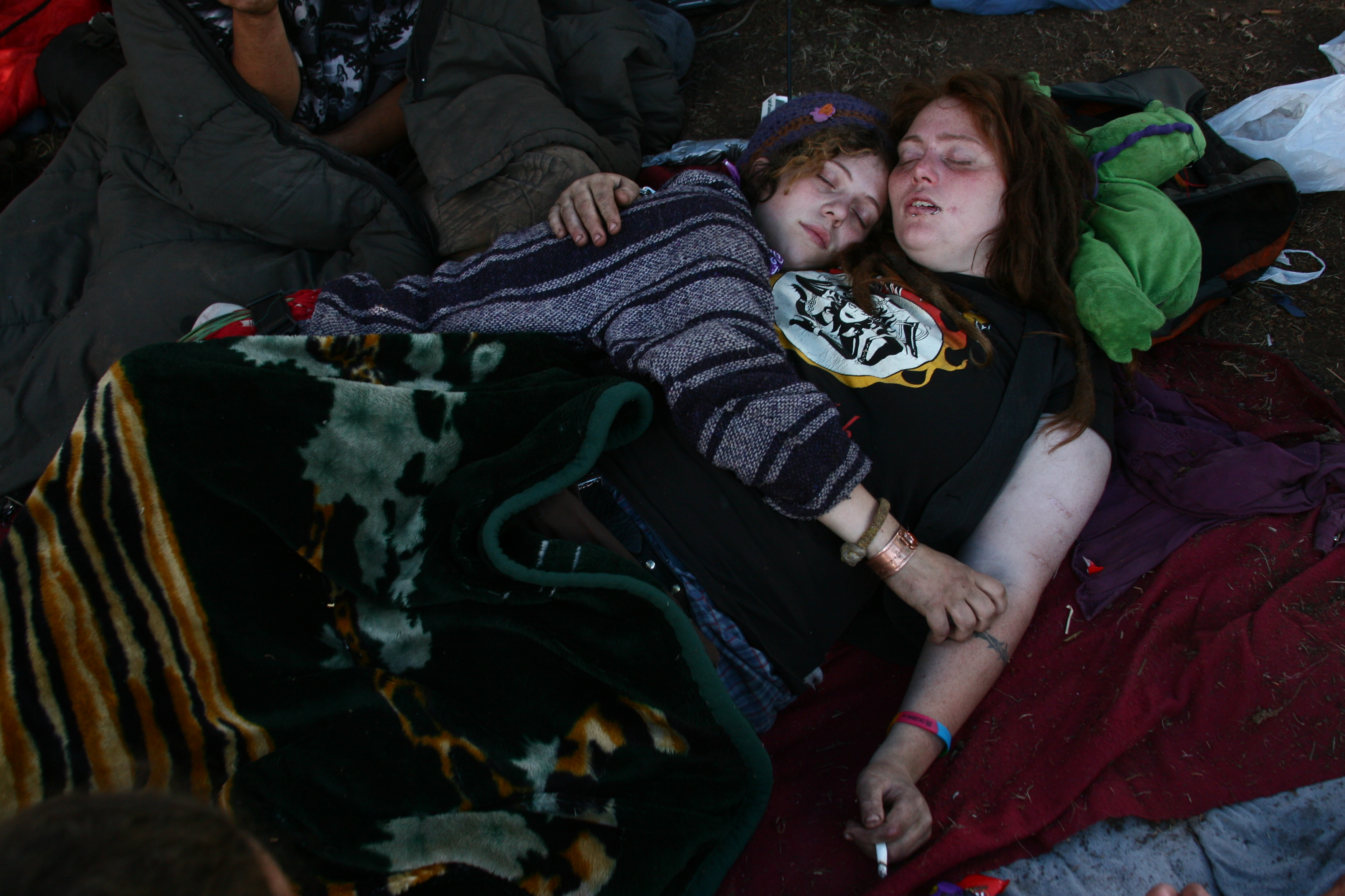 Moe and Sicka fall asleep in each other's arms. New Mexico. 2009. Photo: Kitra Cahana