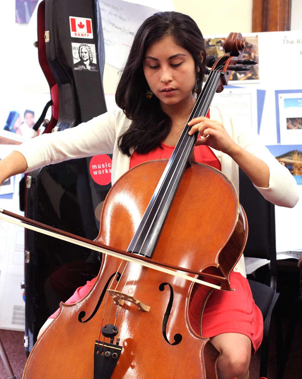 Andrea Landin doesn't just play beautiful music. A graduate of the Sistema Fellows US Program, she got the training she needed to teach children how music can change communities. Photo: Natasha Scripture