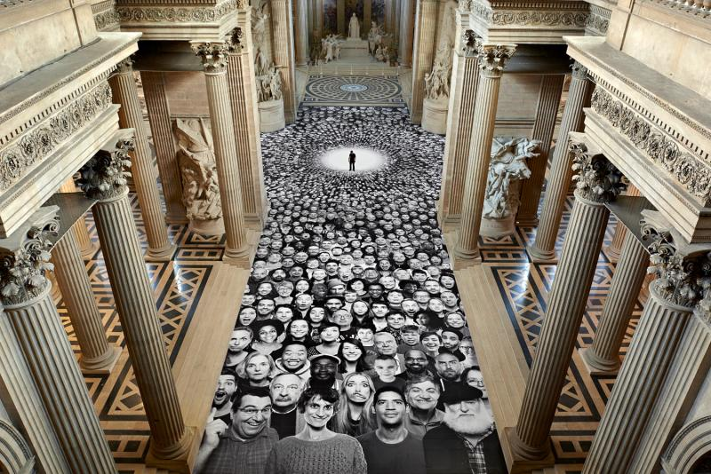 TED Prize winner JR stands in the center of his Panthéon collage. Photo: Inside Out Project