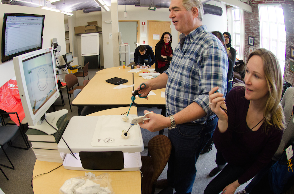 TEDxBeaconStreet Adventures participants practice laparoscopic surgery in Boston. Photo: John Werner